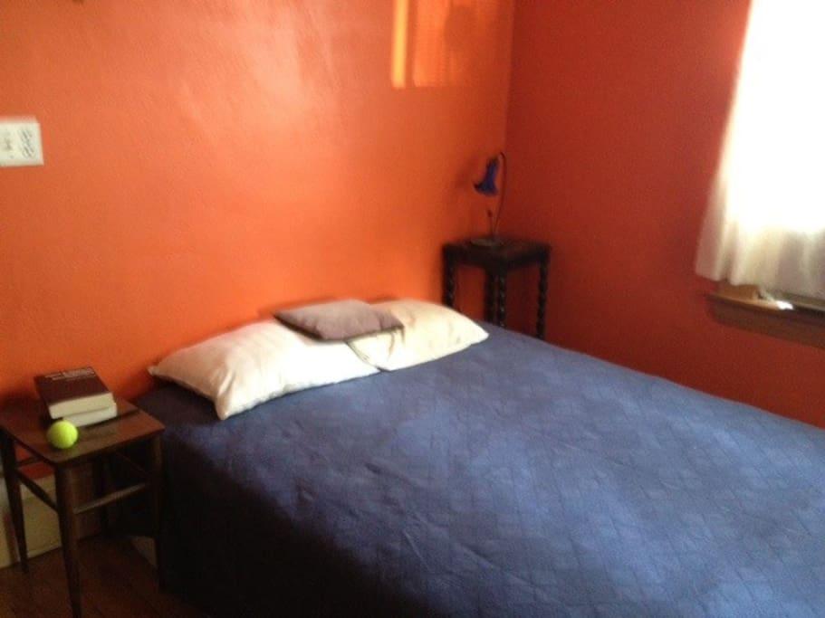 orange bedroom with queen bed