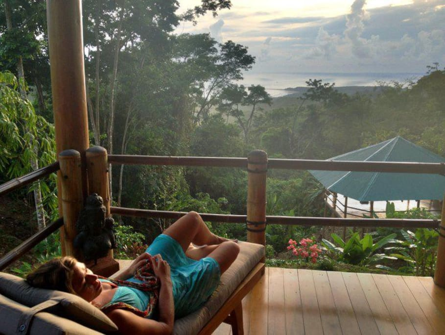 View of jungle, pacific ocean, and our stunning floating yoga deck from main house!