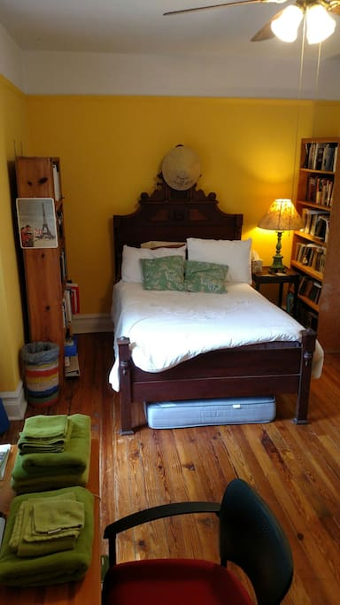 This sunny south-facing room has an antique bed and extra twin mattress.