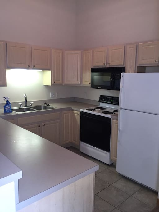 Kitchen includes full set of dishes, pots/pans, and silverware