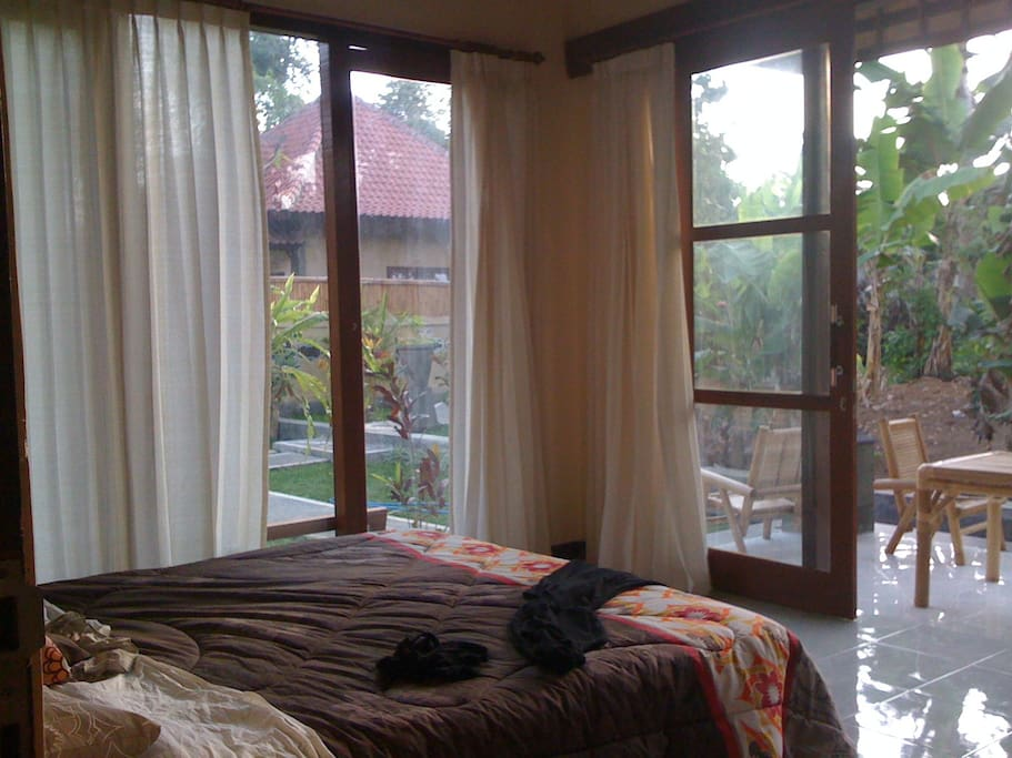 Second bedroom with huge opening windows and garden terrace