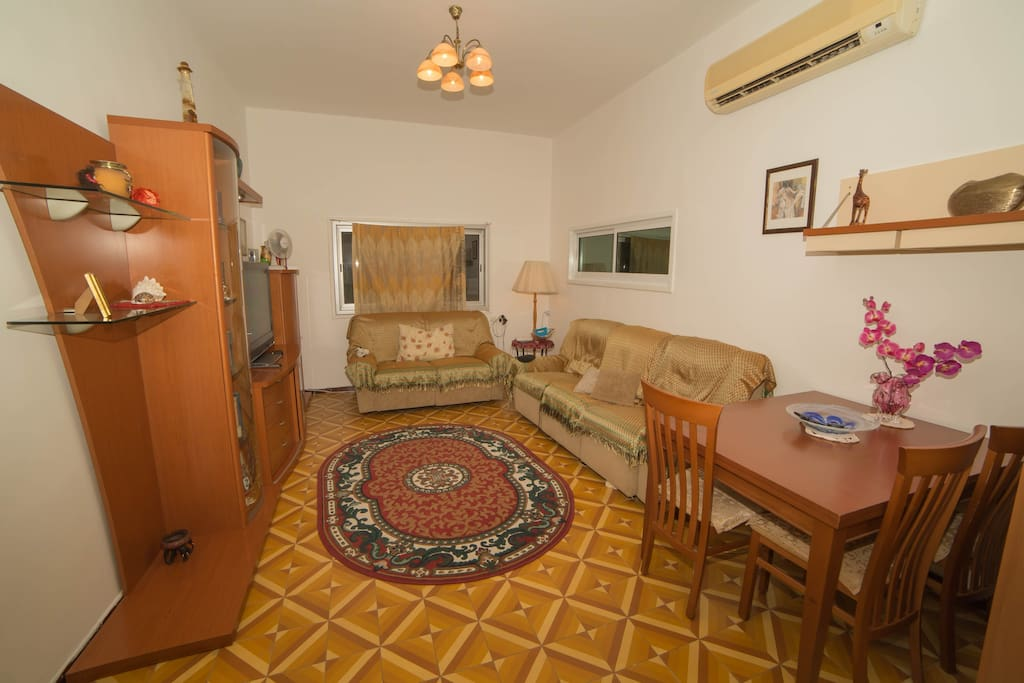 Main room. A/C. American Comfort chairs with recliners, TV, media player, BT speaker