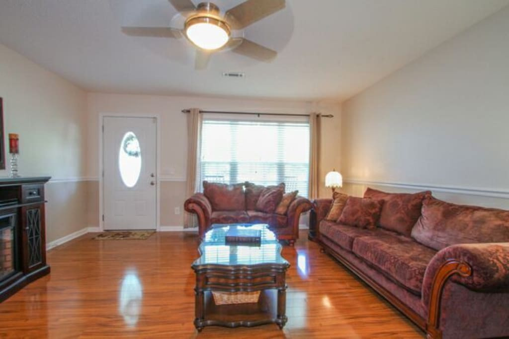 """Spacious Living Room with 46"""" TV and fireplace."""
