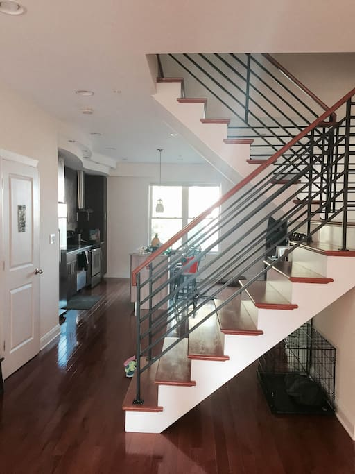 View of kitchen and stairway to 2nd story from the living area.