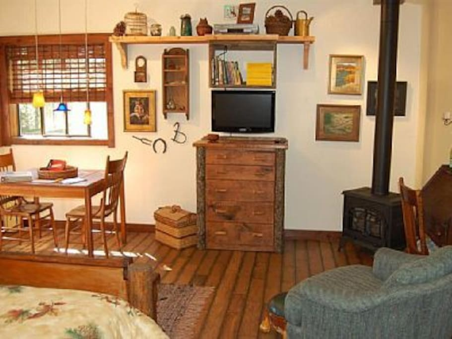 Charming gas fireplace, dresser and dining table. DVD/VCR player with pullout screen.