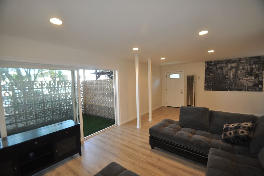 this is the view from large sectional couch out to the private patio.