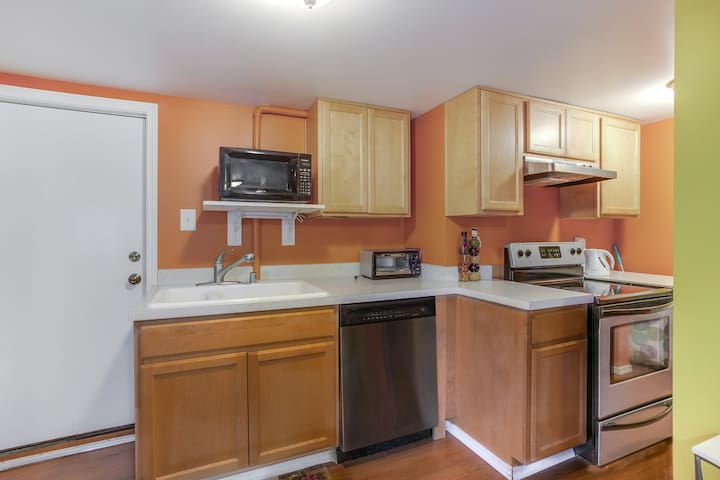 Convenient private entrance and full kitchen with dishwasher, oven/range, rice cooker, and microwave.  Dishes and pans.