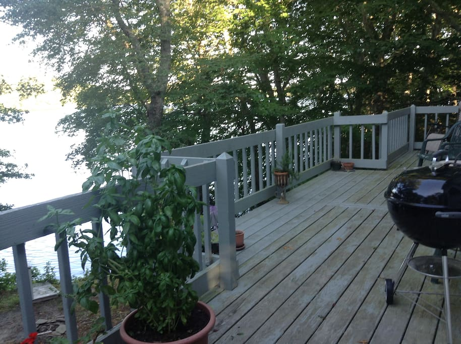 The large back deck which overlooks Santuit pond.