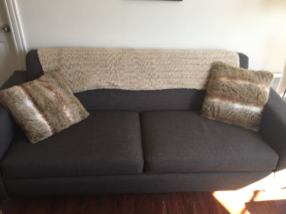 This couch also makes a comfortable bed for a third guest. Most people love it, but there is also an airbed available.