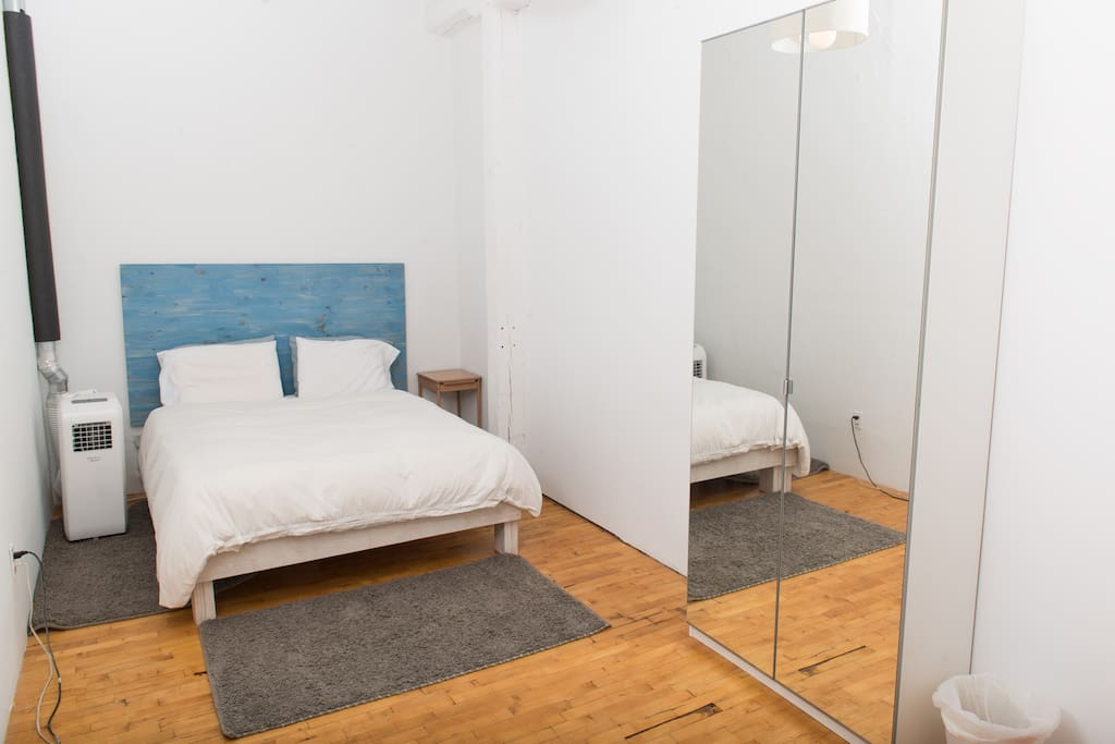 In addition to a queen bed, the guest bedroom also holds a portable air conditioner for hot summer nights, a vintage secretary desk that doubles as a night stand, and a wardrobe for all of your personal belongings, extra bedding, towels and more.