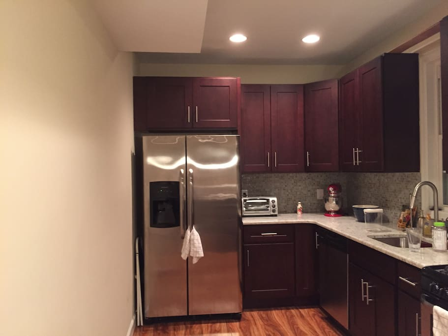 Beautiful kitchen with steel appliances and cherry wood cabinets