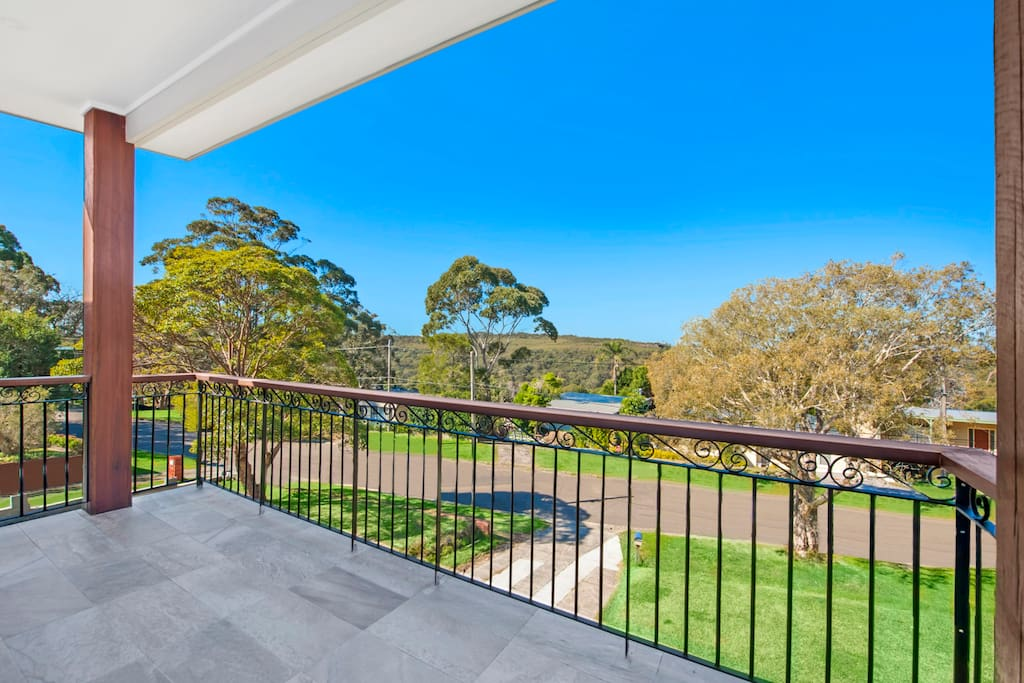 Enjoy the beautiful bushland view that opens up via triple sliding doors to the upstairs living.