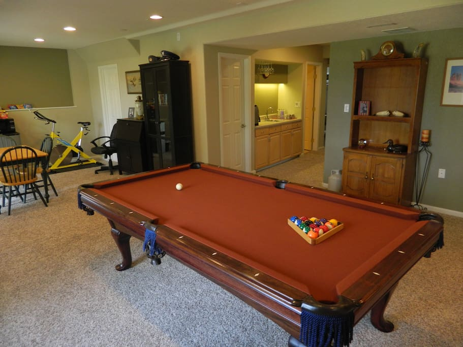 Recreational room view toward inside space - board games are in the lower cabinet of the hutch on the right