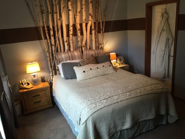 The upstairs bedroom greets our guests with rustic charm and comfort.