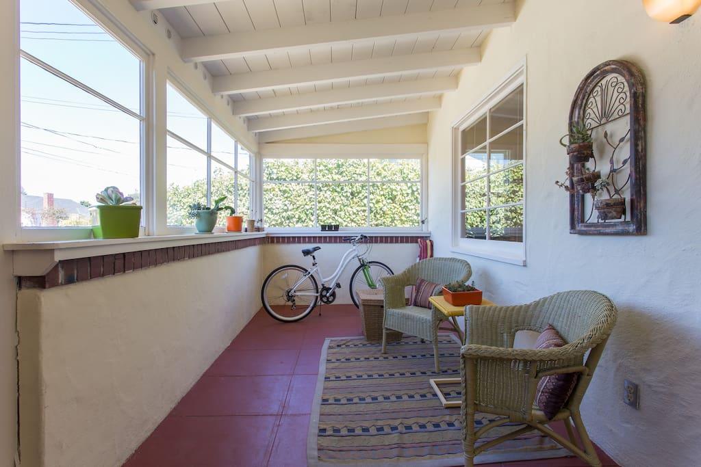 Sunny, cozy enclosed front porch