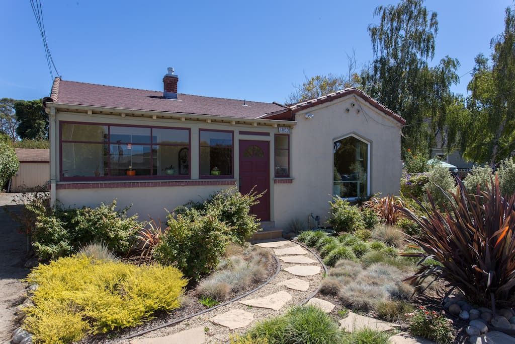 Spanish style home with all drought-resistant plants