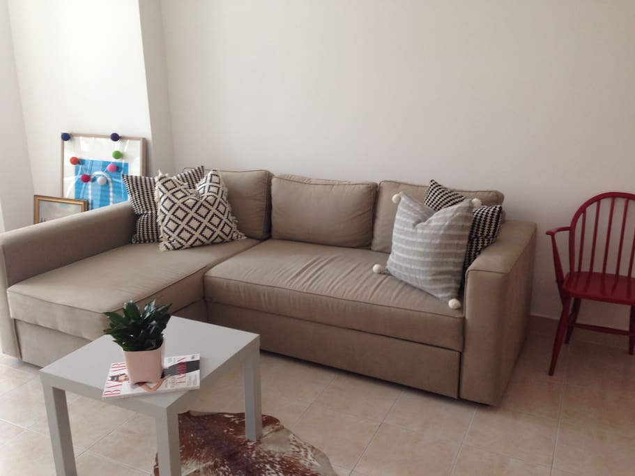 Comfortable L-Shaped couch; perfect for unwinding after a day out shopping or at the beach!