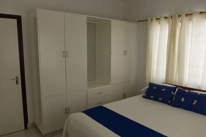 Bed and Storage Cupboards