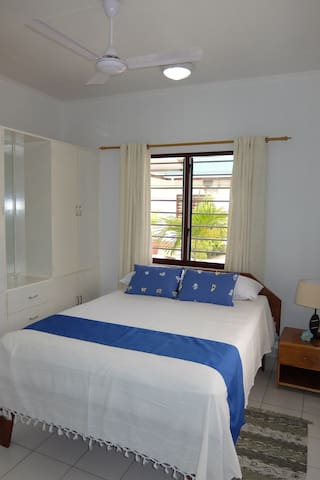 Bedroom With Double Bed and storage , A/C and Ceiling Fan
