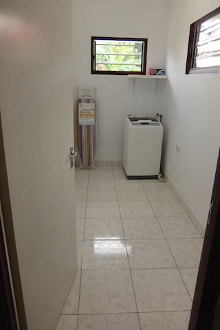 Separate Laundry Room with washing machine