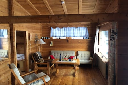 Your escape to a handbuilt log cabin