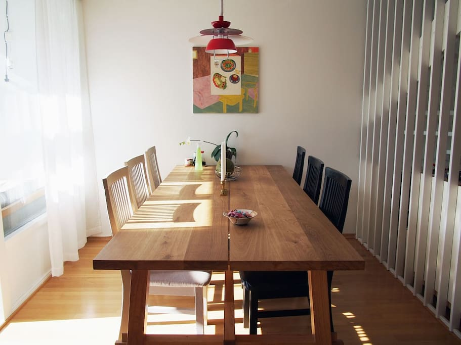The large solid kitchen table is perfect for meals large and small.
