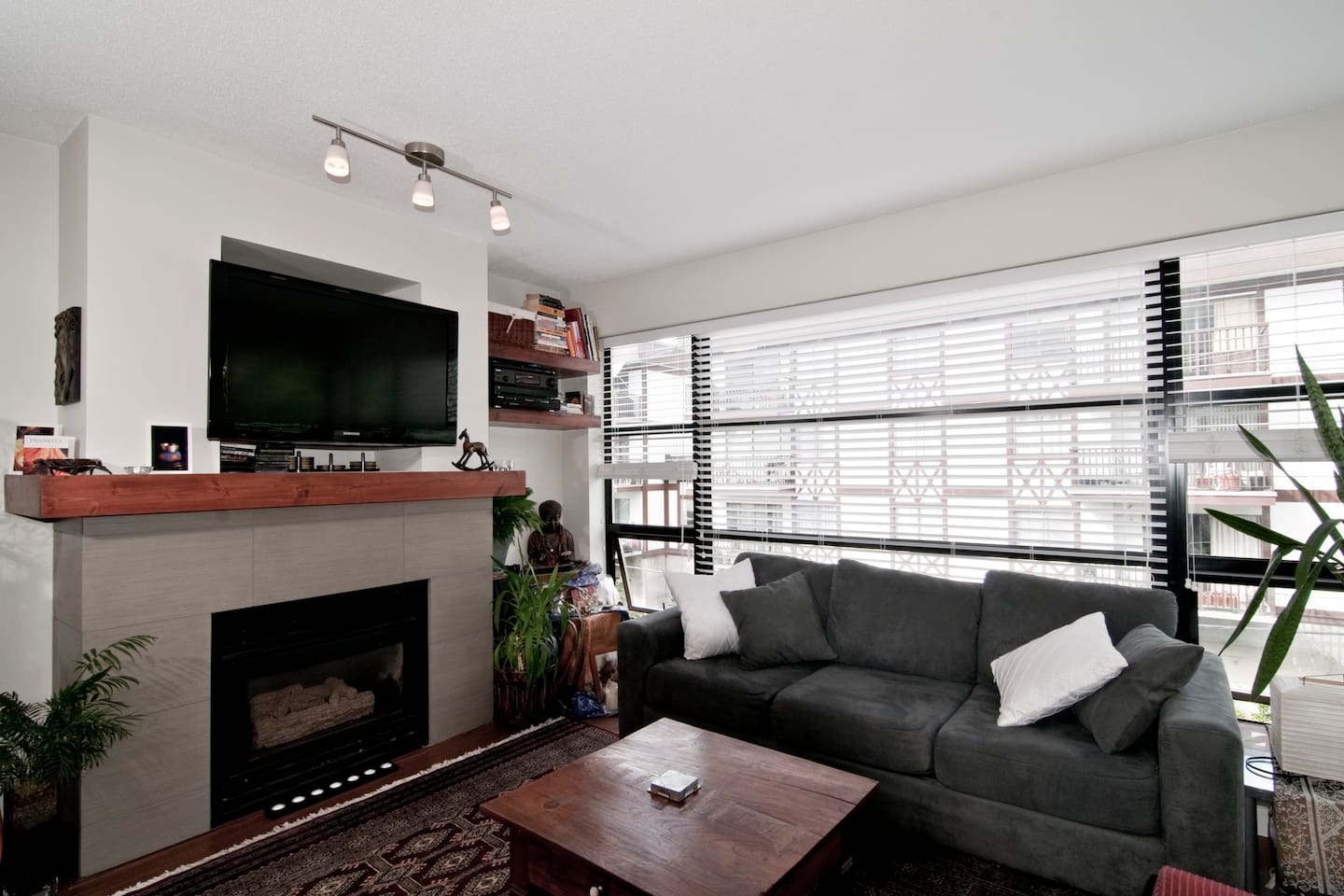 The living room has lots of natural light and 4 different windows to create air flow.