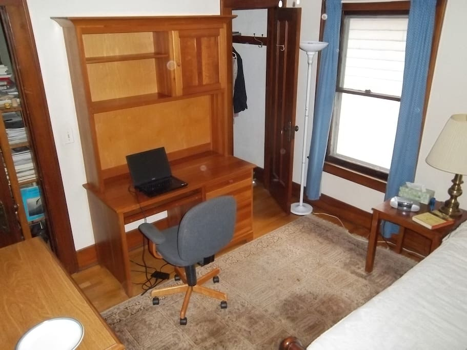 Nice workspace and a closet for plenty of storage.