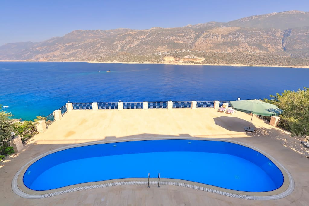 Large shared swimming pool with sea views.