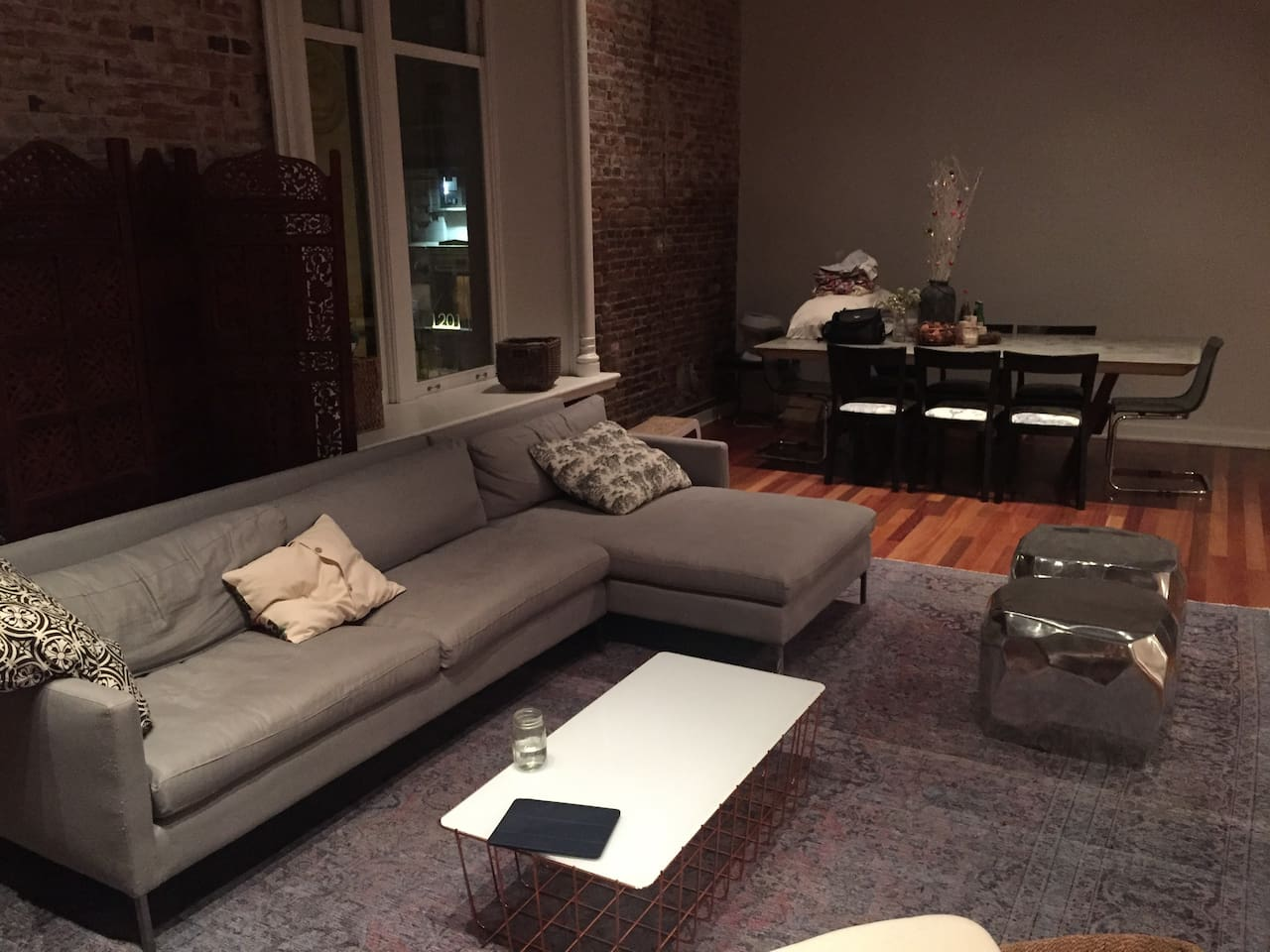 L shaped couch.  Dining room table comfortably sits seven