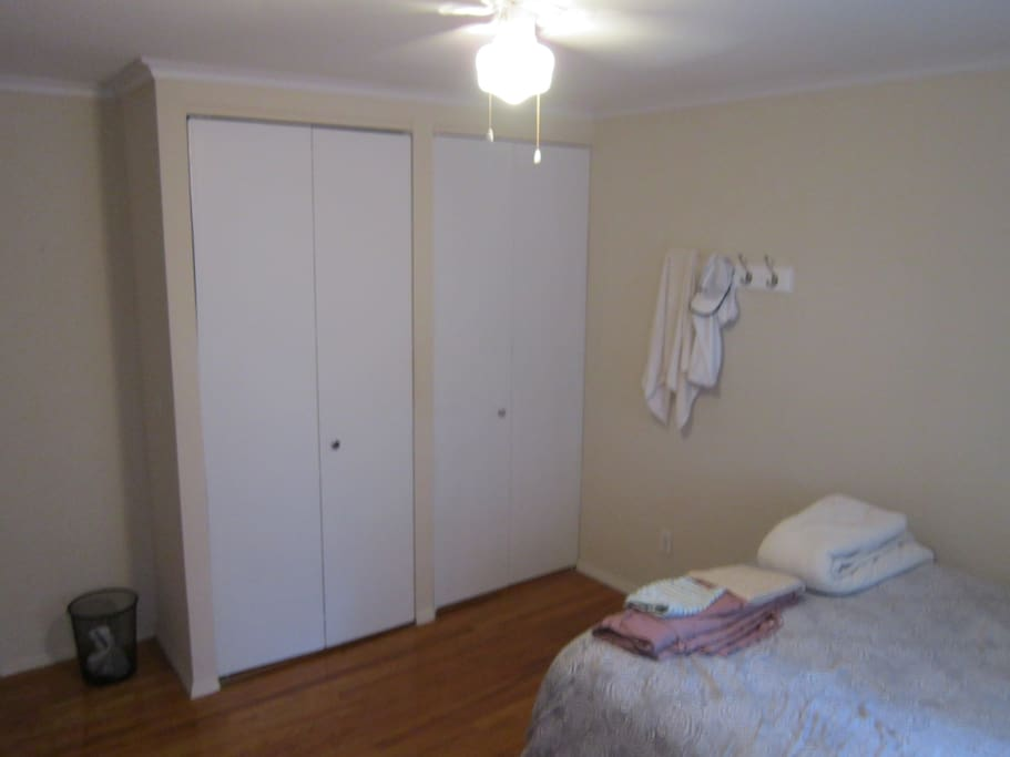 A look at the closet, opposite the bed