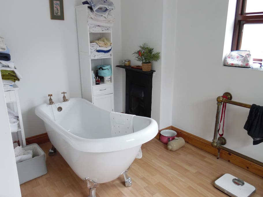 Shared bathroom - roll top bath and showers