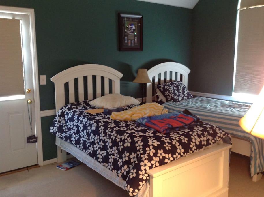 Twin bed, both rooms have second floor deck
