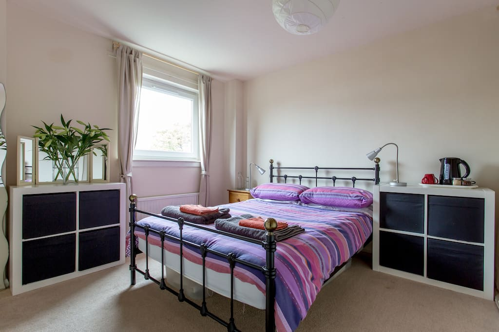 Bright bedroom with comfy double bed.