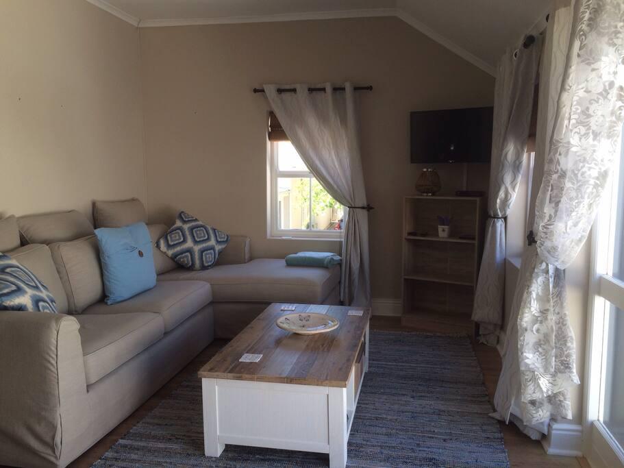 Large lounge opening onto large balcony