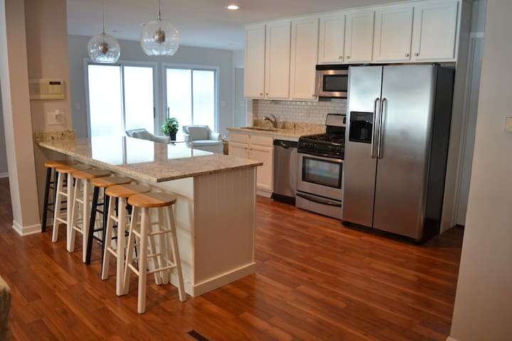 New kitchen with gas stove and large island that seats 6+ people.