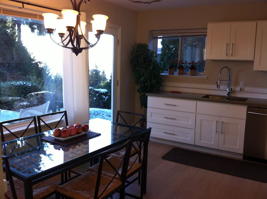 Newly Renovated kitchen with ocean view. Kitchen table seats 6.