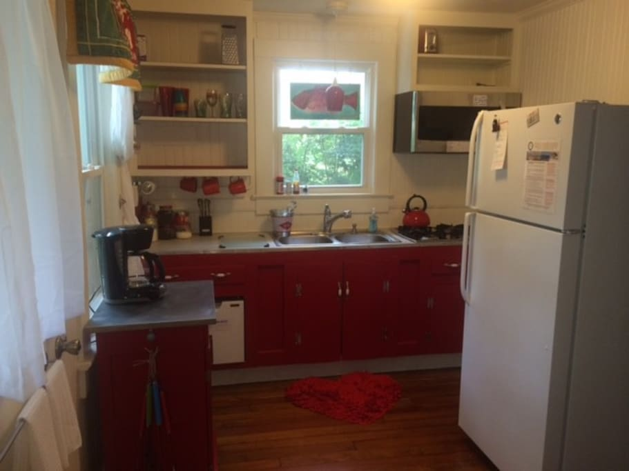 Enjoy a full size kitchen with gas cooktop, convection/microwave oven, frig and dishwasher.