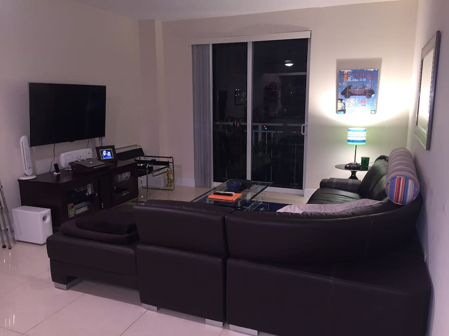 Main living room 56 inch LCD flat panel TV, surround sound, wifi internet & basic cable. Hurricane impact glass/ soundproof windows.