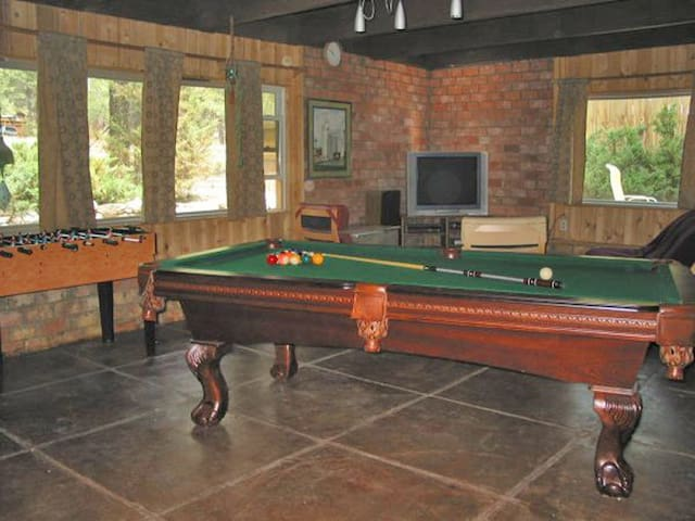 Game room with pool/ping pong table