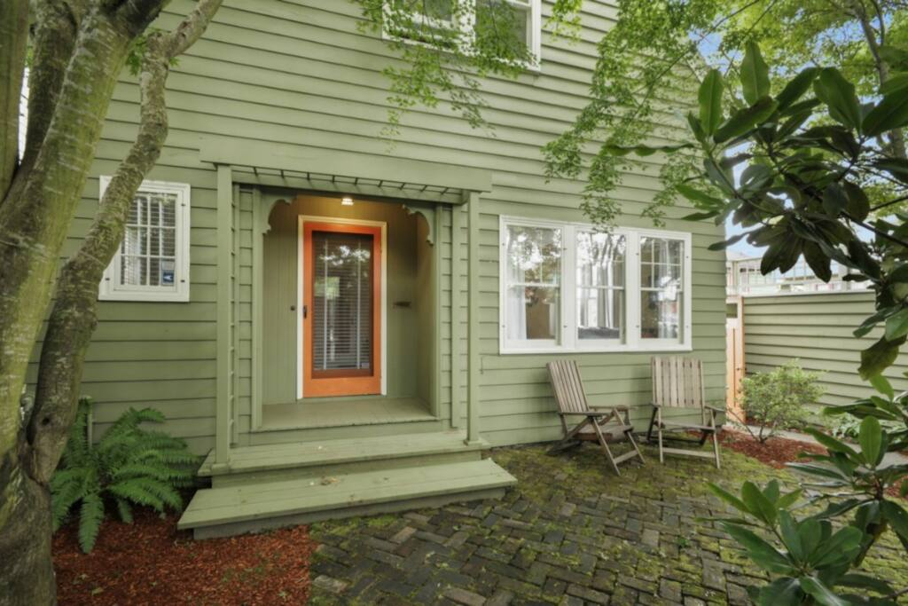 Enclosed, tree-filled front courtyard feels like a private sanctuary from a bustling city