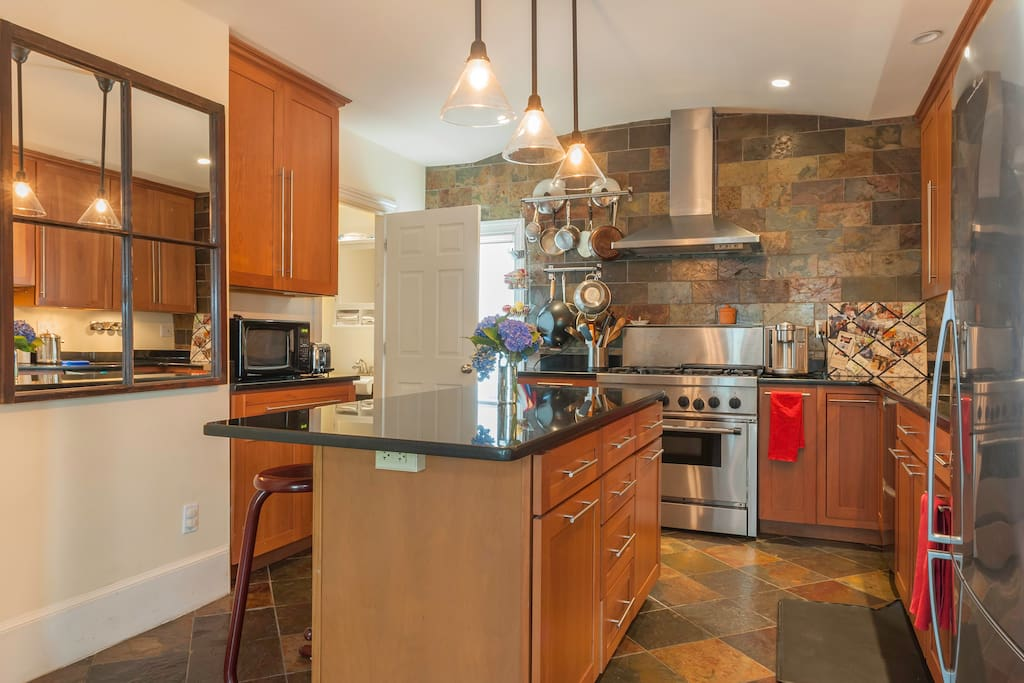 Chef's kitchen with granite counters, 6 burner stove, and all the usual necessities.