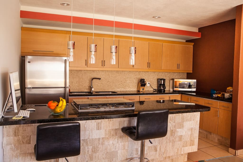 modern kitchen with all appliances , dishes and cookware