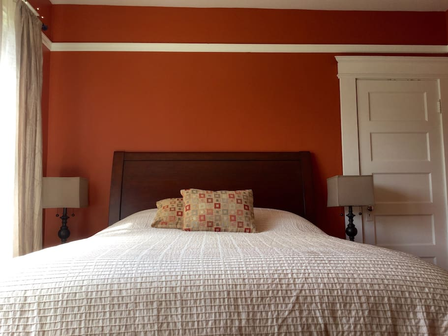 new queen-size bed with 100% cotton bed linens and pottery barn bed-frame.
