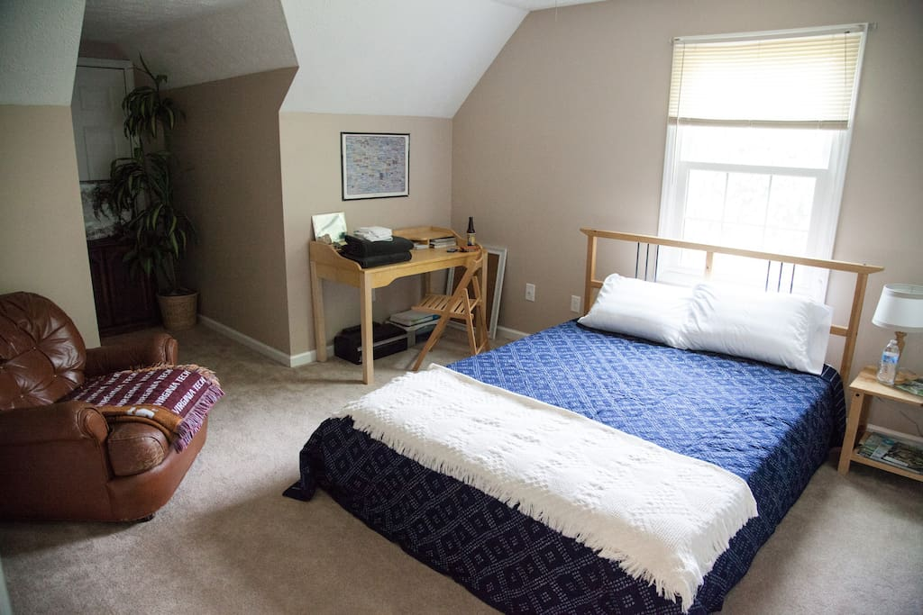 Second guest bedroom with queen-sized bed on private upper floor.