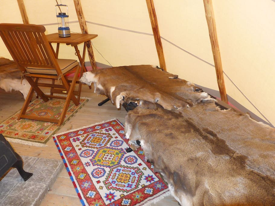 The cot covered with deer hide