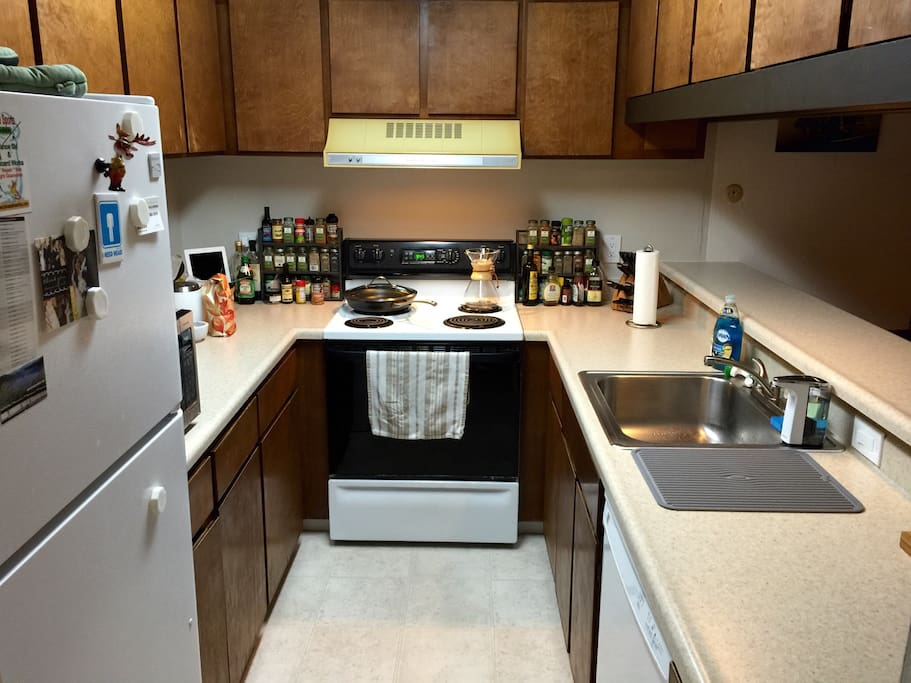 Fully equipped kitchen with breakfast bar ready to go.