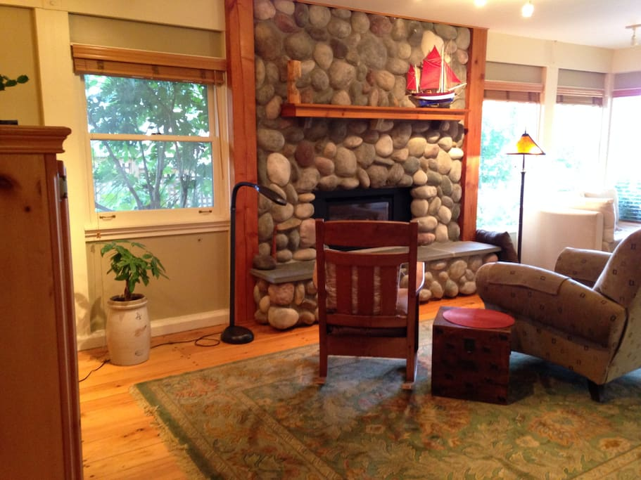 Stone fireplace in spacious living area.