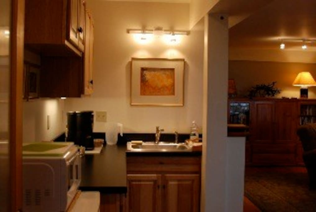 Kitchen nook with coffee pot, tea kettle, microwave, toaster oven, hot plate, mini frig.  Complimentary coffee, tea, granola, yogurt and milk.