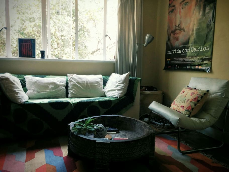 The comfortable couch placed near the window allows guest to enjoy the morning shine and the greenery that the gardens provide.